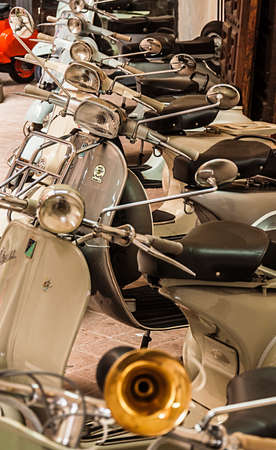 Urbino - NOVEMBER 3: Old Vespa scooters in an historical museum on November 3, 2013 in Urbino, Italy
