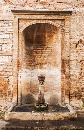 italian fountain: olf italian stone fountain in the village in central Italy
