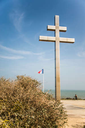 anniversary beach: the Lorraine cross as symbol of the memorial at Juno Beach, France Editorial
