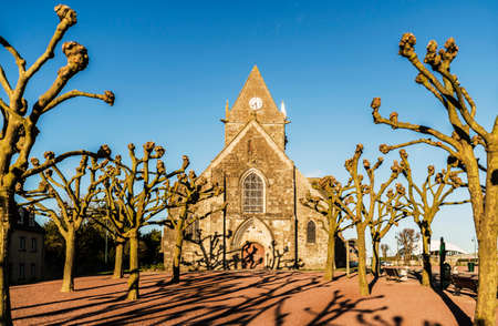 mere: the historical church of Sainte Mere Eglise in Normandy, France