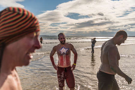 plunging: OLD ORCHARD BEACH - JANUARY 1 2016: several hundred people took part in the annual Lobster Dip Plunging on January 1, 2016 in Old Orchard Beach, Maine USA