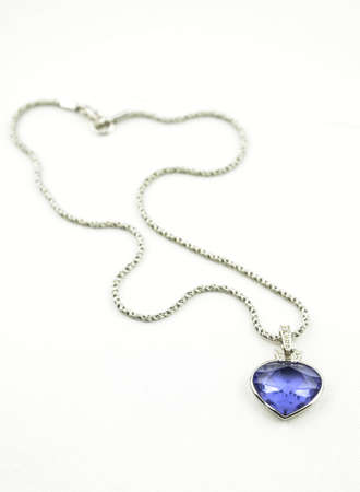 neckless: A beautiful pendant with a blue gemstone on the silver neckless isoalted on white studio background.