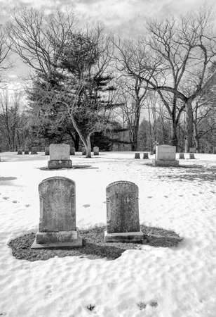 gravestones: early american gravestones and cemetery  covered in snow