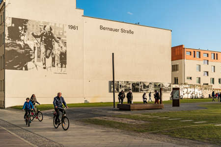 depict: BERLIN - APRIL 3: The Berlin Wall Memorial in Bernauer strasse. This is the intersection with Acker strasse and the photos depict the place over the years on April 3, 2015 in Berlin, Germany.