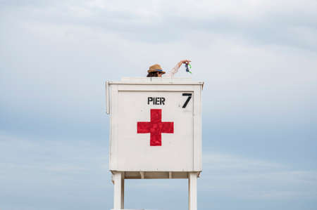 life guard stand: Toursit on baywatch tower on a beach in Maine, Usa