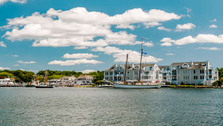 Mystic Seaport, is an outdoor recreated 19th century village and educational maritime museum. Visitors will find a lighthouse replica of Brant Point Light. Stock Photo - 54683075
