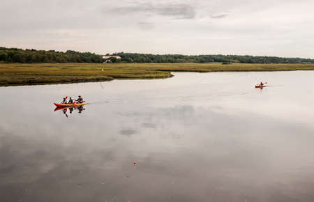 wells: WELLS, ME - AUGUST 21: Family kayaking in winter on the coast of Maine on August 21, 2014 in Wells, Maine USA