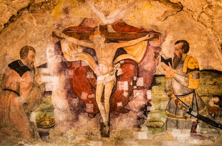 italian fresco: Old fresco with Jesus crucifixion inside the medieval church in Basilicata, Italy Stock Photo