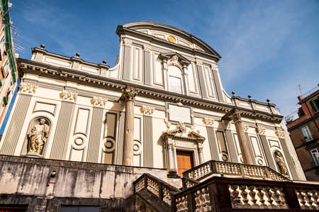 view of the facade of Basilica di San Paolo Maggiore San Paolo Maggiore Church on Via dei Tribunali in Naples, Campania, Italy. Stock Photo