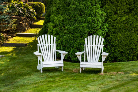 adirondack: two adirondack chairs on the grass in Maine, USA