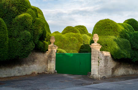 A gated English garden in the small town of Corsham, England Stock Photo