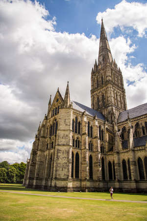 SALISBURY - JULY 17: the famous view of the Cathedral and park on sunny and cloudy day, on July 17, 2015 in Salisbury in South England