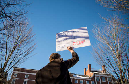 PORTSMOUTH, NH, USA - FEBRUARY 19: people protest on the street against the US President Donald Trump on February 19th, 2016 in Portsmouth, NH.