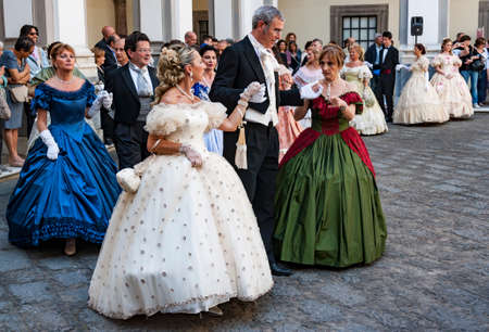NAPLES, ITALY - MAY 12: Ladies and gentlemen in ball suits of the 19th century inside the Chiostro of St. Lorenzo on May 12, 2013 in Naples, Italy. Editorial