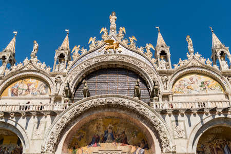 ancient lion: Facade details of Basilica San Marco in Venice, Italy