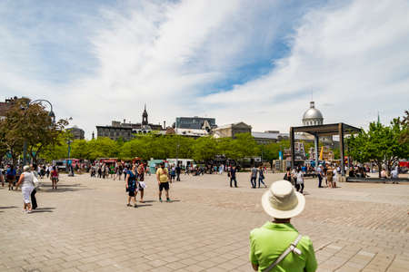 MONTREAL, MAY 28, 2015. Crowd of tourists enjoying the various activities at the historical Old Port in Old Montreal, Canada.