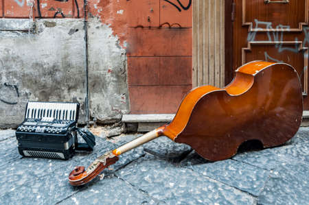 Performance of street musicians, contrabass and accordion