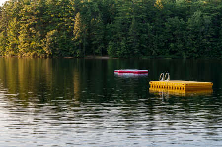 lake with a large wooden platform in Maine, USA