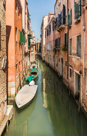 beautiful view of the canal with a floating boat in Venice, Italy Stock Photo