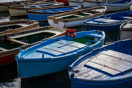 Colored fishing boats in the bay of Naples, Italy
