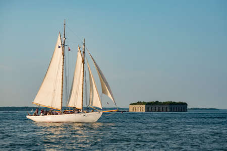 a Tall ship passing Fort Gorges on Hog Island Ledge in the Casco Bay at the entrance to the harbor at Portland, Maine