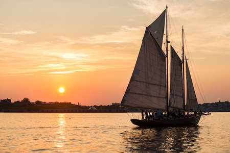 a Tall ship at sunset in the Casco Bay at the entrance to the harbor at Portland, Maine