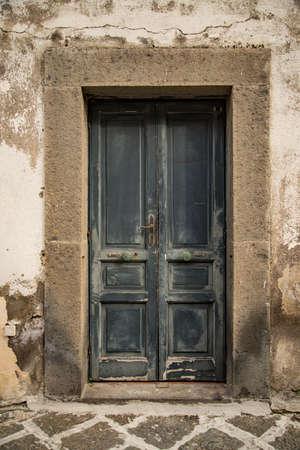 Old italian vintage door in Naples, Italy Stock Photo