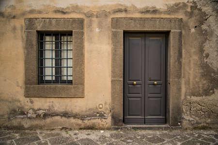 Old italian vintage door and window in Naples, Italy