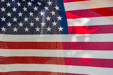 Closeup of grunge American flag with the sun on the back Stock Photo