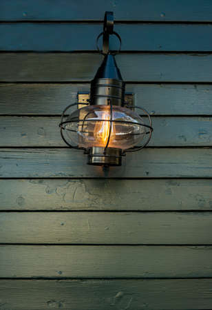 glowing old street lamp on the wall in Kennebunkport Maine, USA