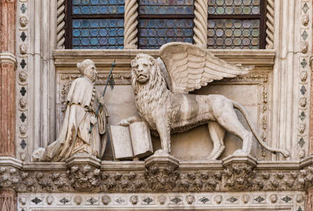 the Dodge duke palace facade with the lion symbol of the Republic in Saint Mark square in the beautiful city of Venice in Italy Editorial