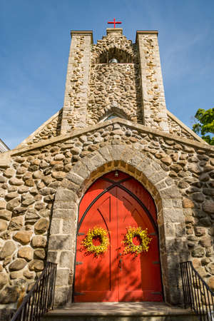 Facade of an old church made in stone in a small village in New England, USA