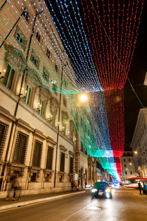 Via De i Condotti during the Christmas holiday, with Italian flag as lights decorations in Rome, Italy Stock Photo