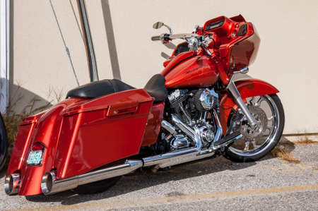 OLD ORCHARD BEACH, ME - AUGUST 19: Harley Davidson Old motorcycle, solid red tone. On August 19, 2012 in Old Orchard Beach, Maine