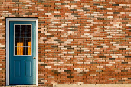 Traditional American building Door on the brick wall in Wells, Maine USA