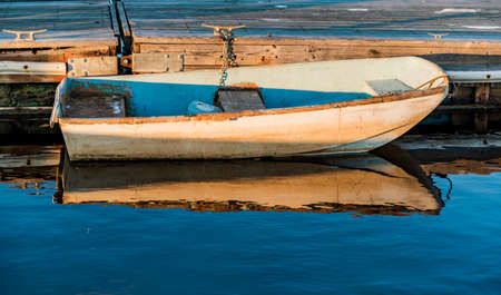 a small boat on the oceanic coast in Maine, USA Stock Photo