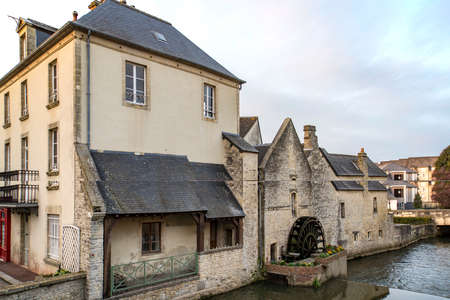 Old water canal in city of Bayeux in Normandy, France