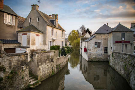 Old water canal in city of Bayeux in Normandy, France Stock Photo