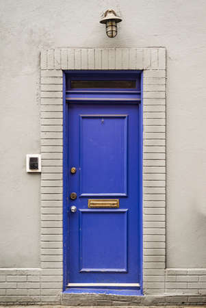 Beautiful entrance blue door, Manhattan New York, USA. Classic apartment estate in New York City. Beautiful view of midtown property, NYC. Stock Photo
