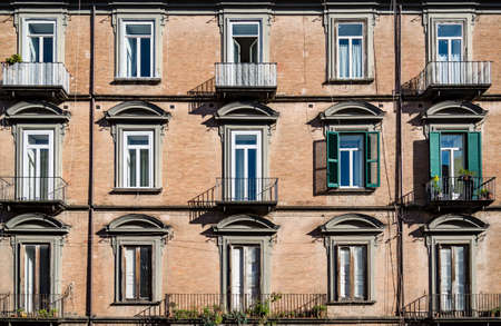 Windows in old building on the streets of Naples old town Italy