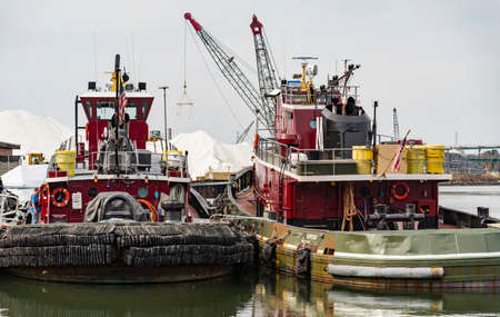 PORTSMOUTH, NH - FEBRUARY 25, 2016: Tugboats in Portsmouth harbor, NH Their engines typically produce 680 to 3,400hp, but larger boats used in deep waters can have power ratings up to 27200hp. Redakční