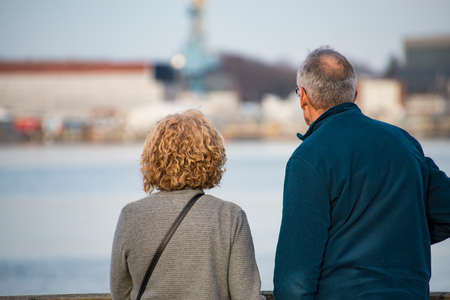 senior couple from behind looking at the panoramic view in Portsmouth NH, USA