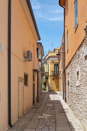 Venosa, Italy, A narrow street among the old houses of a medieval town. Stock Photo
