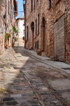 Narrow street in the small town of Spello, Umbria region, Italy