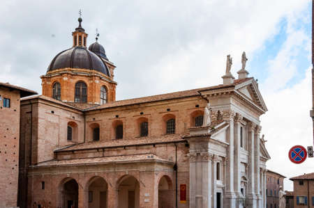 View of the facade and the cupola of the neoclassical Duomo di Urbino, Urbino Cathedral in the Marche, Italy.