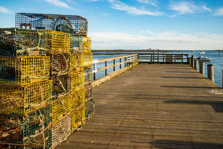 A stack of lobster traps and rope tied together on a fishing pier in Cape Porpoise, Maine.