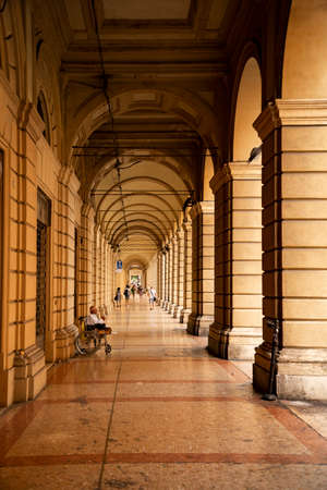 Columns and arcades, Portico, typical of the city downtown in Bologna, Italy