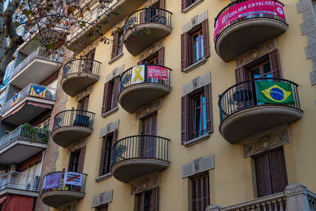 BARCELONA, SPAIN- DECEMBER 19, 2018: Old styled Building with signs about Catalan independence. in downtown Barcelona, on December 19, 2018 in Barcelona Spain Editorial