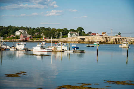 Boats and warehouse on a dock on the Maine coast fishing port