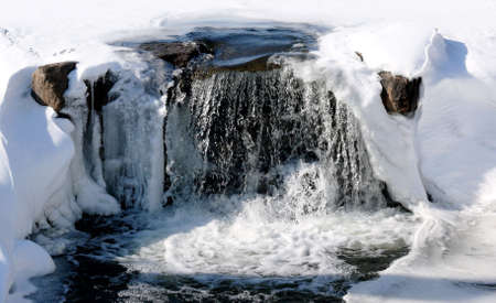 small waterfalls from a frozen lake in ontario, canada; picture taken in early march